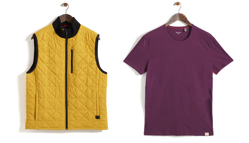 Mens clothing photography. yellow gilet and purple t-shirt hanging on the wall from coat hangers
