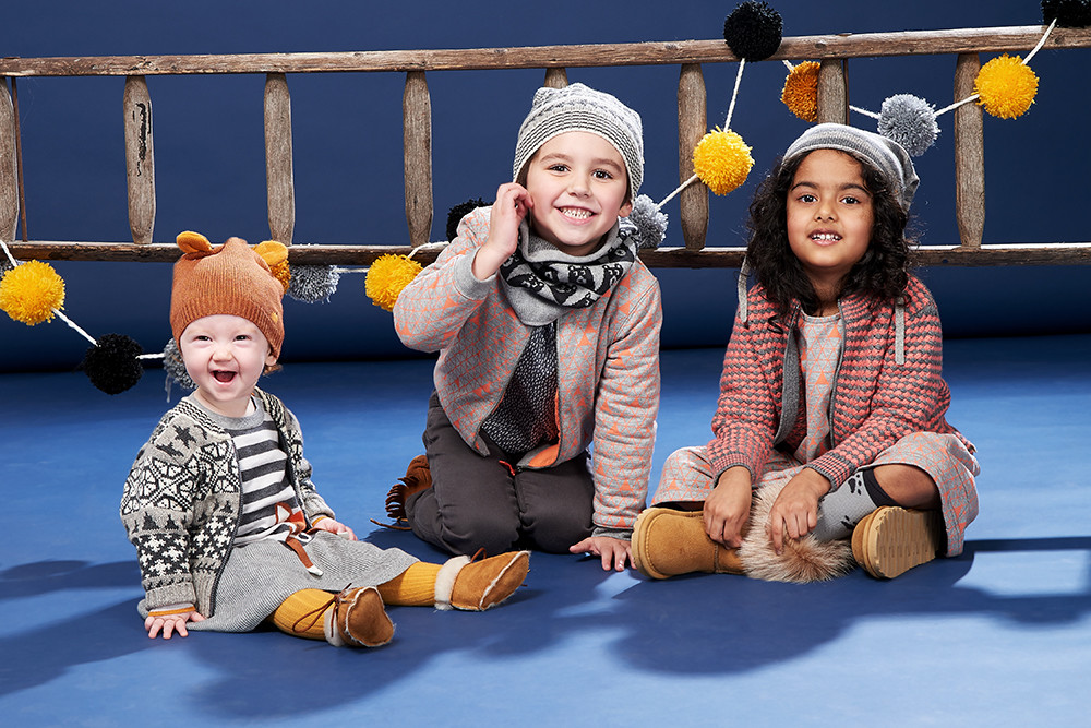 Children's & Baby Clothes Photography, children modelling knitted clothes in front of a ladder