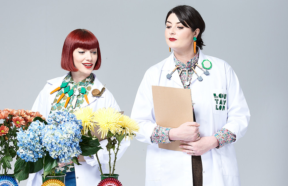 Jewellery photoshoot Brighton studio, Photography Brighton, two female models holding clipboards, wearing jewellery and white coats with fresh flowers
