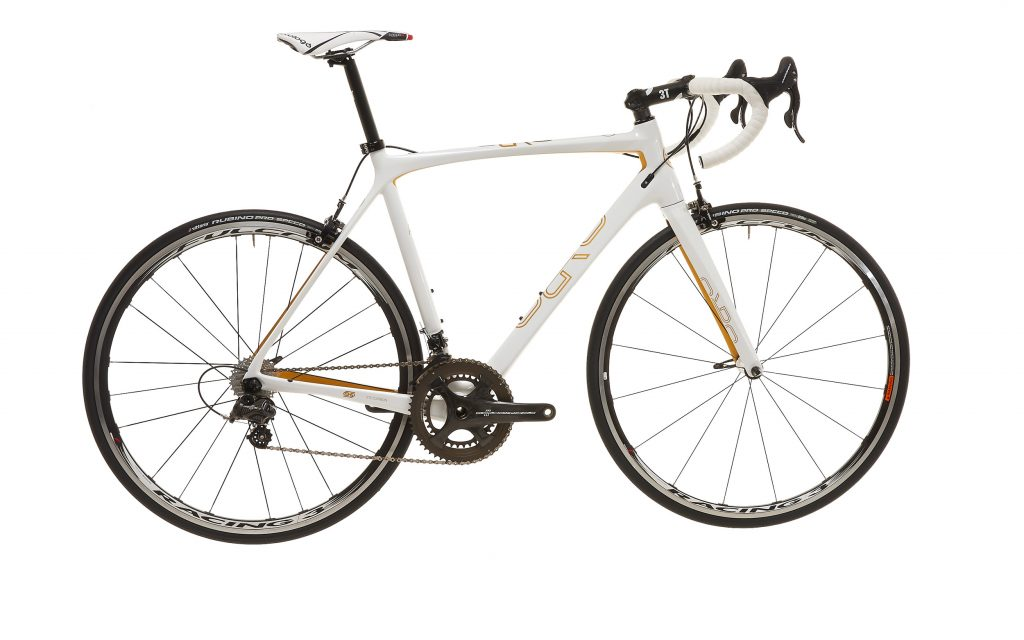 product photography of a white bicycle with gold paintwork