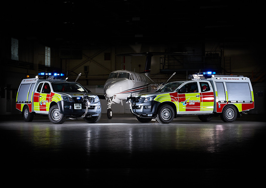location photoshoot, cars and aeroplane at an airport