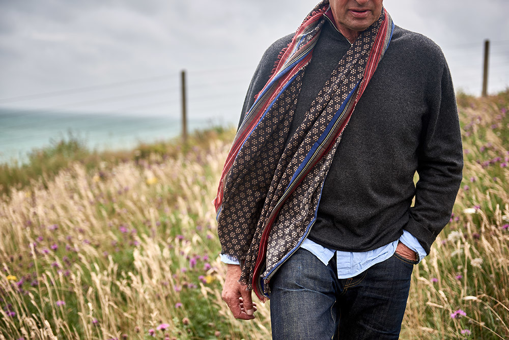 Brighton location photoshoot with a male model wearing a scarf and grey jumper on Sussex beach