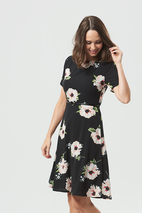 model fashion photoshoot, female model wearing floral black dress