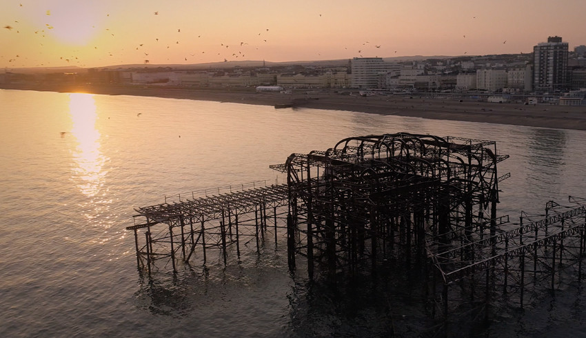 Brighton Photography, Sussex video production, a drone shot of the iconic West Pier in Brighton in front of a sunset