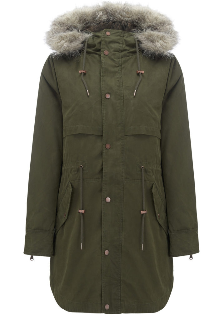 Invisible mannequin winter fashion photography, green parka with fur trim hood