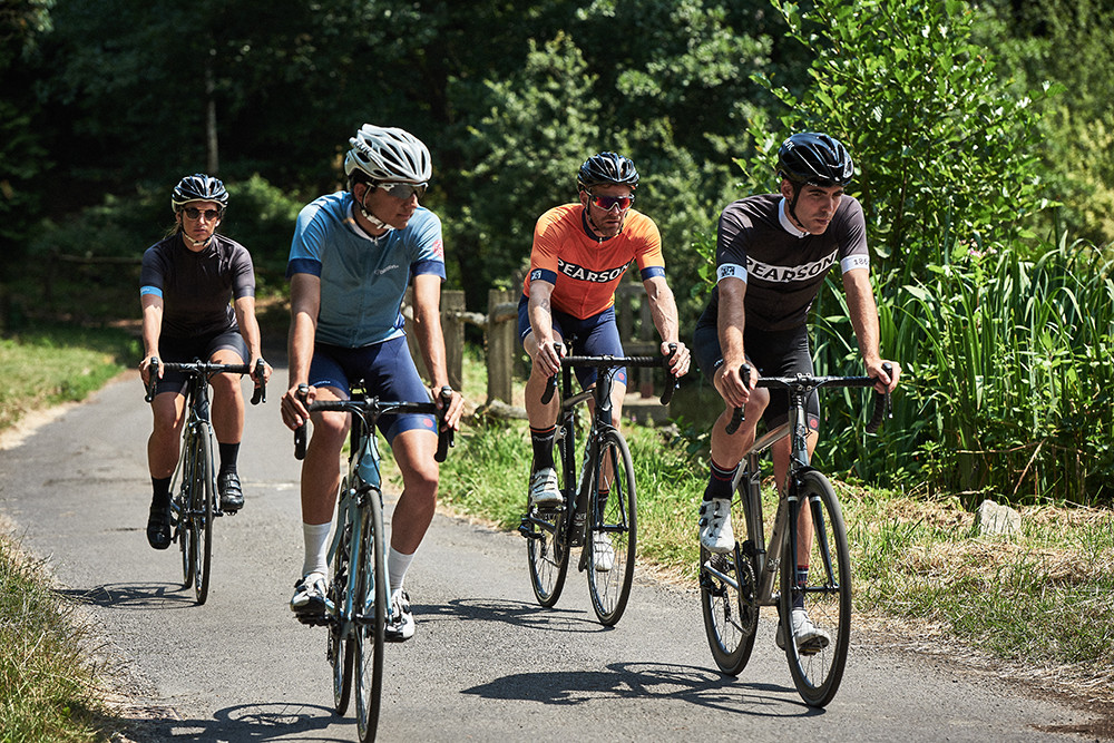 bike & cycle wear location video, group of cyclists riding along a country lane