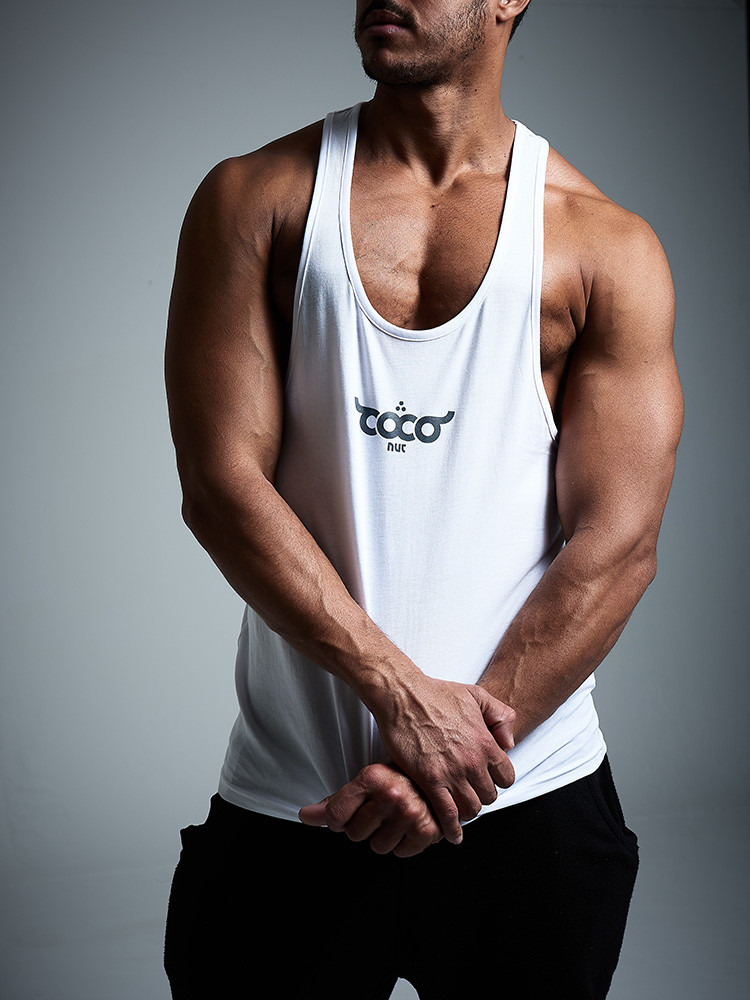 Sussex model photoshoot, male model wearing a white tank top