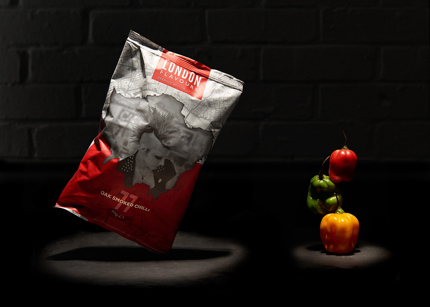 professional photography, Food & Drink Photography, commercial photograph for crisps against a black background