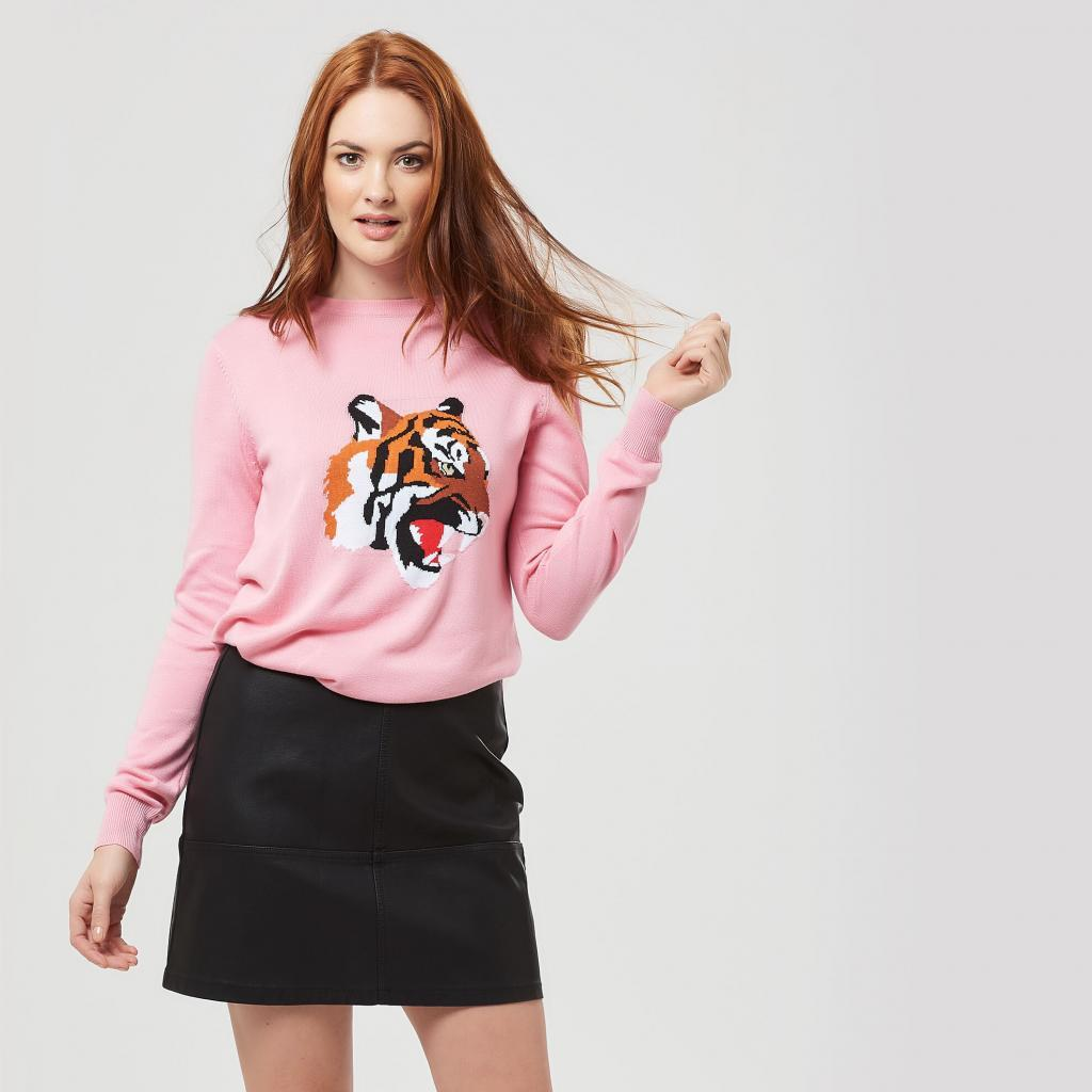 Charity fashion photoshoot, female model wearing pink tiger jumper and black leather skirt