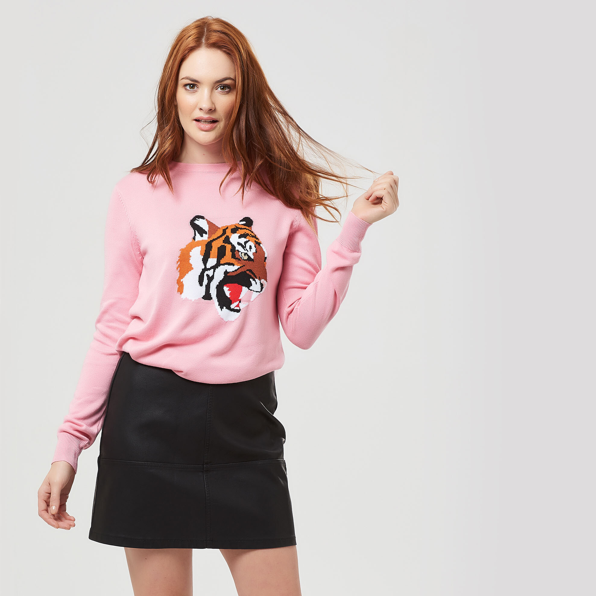 Pink tiger jumper and leather skirt outfit