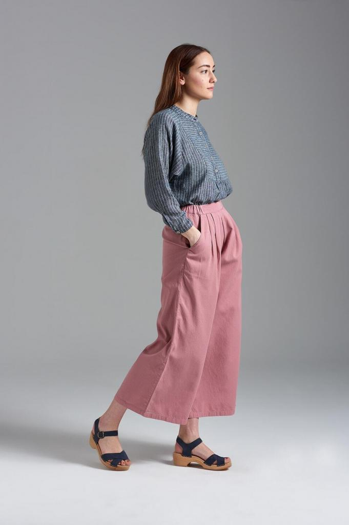 Stylish fashion photoshoot, female model wearing pink culottes and grey shirt