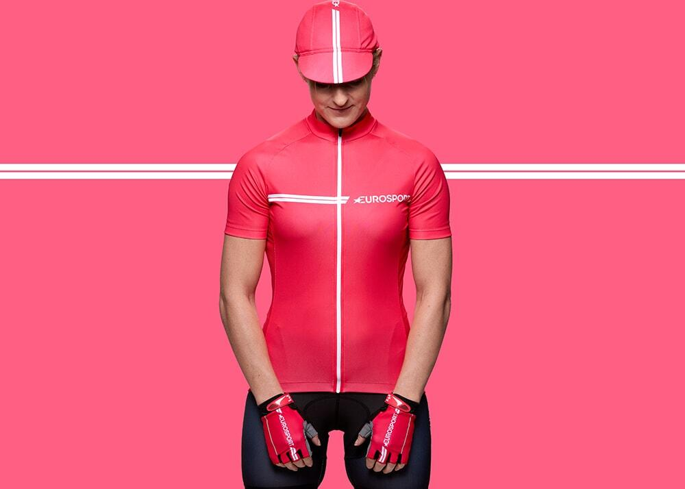 Cyclewear photography, female model wears pink cycling top, hat and gloves