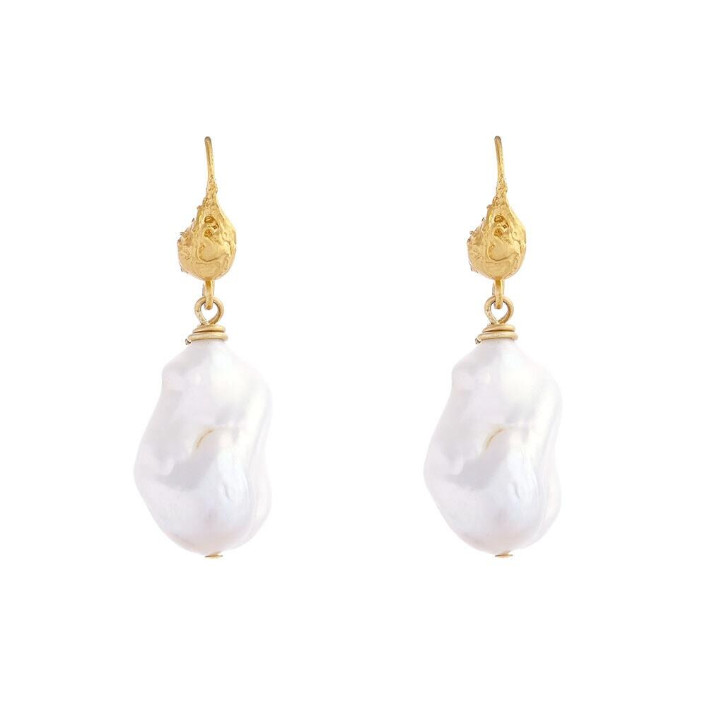 on location jewellery photo shoot, pearl earrings on white background in studio shoot
