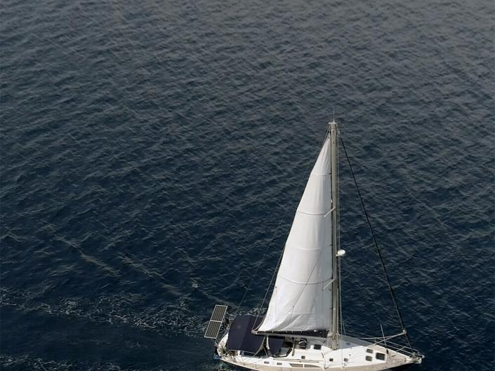 Aerial drone shot of sailing boat in ocean shot from above on location shoot in Brighton
