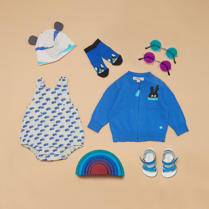 Beige and blue childrenswear styled flatlay photoshoot with props in sussex photography studio