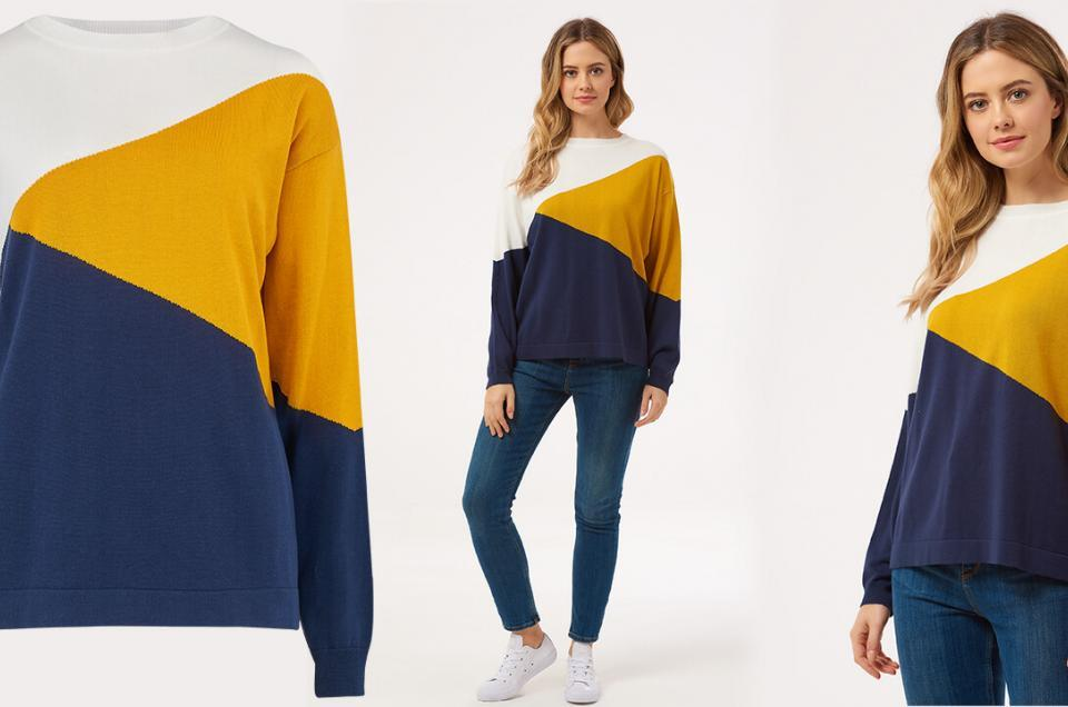 E-commerce photography for a Brighton boutique of a mustard, navy and white jumper worn by a female model. Invisible mannequin product photography a colourful jumper.