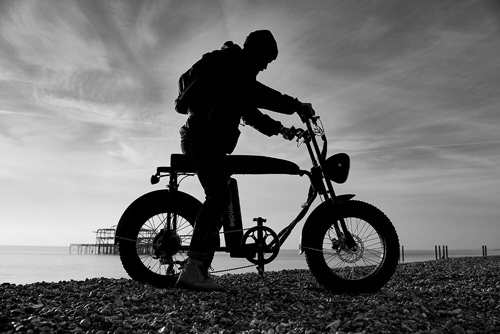 Electric bike on Brighton beach, fashion photography studio