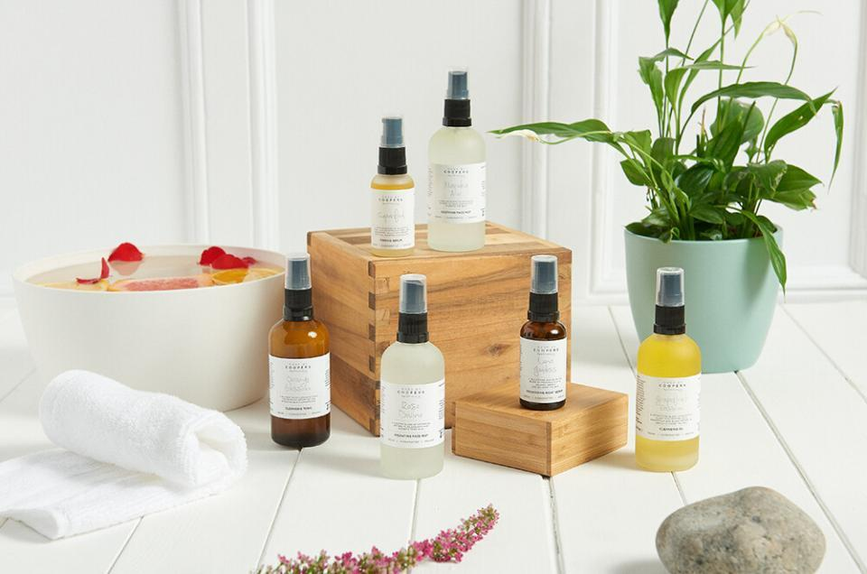 product photography studio, clean lifestyle image of beauty products in a bathroom with plants